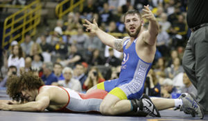 Ben Provisor, top, reacts as he defeats Jordan Holm in their 85-kilogram Greco Roman match at the U.S. Olympic Wrestling Team Trials, Saturday, April 9, 2016, in Iowa City, Iowa. (AP Photo/Charlie Neibergall)