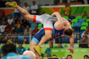 Sergey Semenov of Russia lifts Heiki Nabi of Estonia for points en route to winning bronze during 130kg Greco Roman wrestling action on Monday, August 15, 2016.